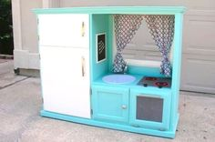 Old TV Entertainment center to play kitchen! I could see this made into a work bench with tool storage too! Old Entertainment Centers, Entertainment Center Makeover, Diy Entertainment Center, Diy Play Kitchen, Childs Kitchen, Play Kitchens, Kitchen Ideas, Kitchen Storage, Woodworking For Kids