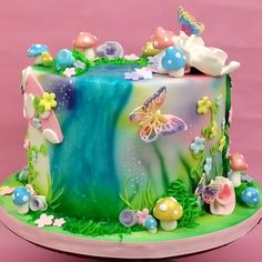 This is the side of a magical fairy garden cake. This is a perfect birthday cake for a little girl at any age! Tinkerbell Birthday Cakes, Garden Birthday Cake, 7th Birthday Cakes, Bithday Cake, Fairy Birthday Party, Birthday Cakes Girls Kids, Birthday Ideas, Fairy Garden Cake, Garden Cakes
