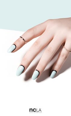 What Dreams Are Made Of - Minimal pastel blue nail wrap with black orbit nail art