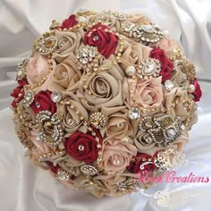 A very unique custom made bouquet I made this summer... The Amira Bouquet. Made with foam roses in beige, dusty pink and ruby red roses; gold brooches and jewels, diamanté trails, crystals and pearls. Book your bouquet for 2016! Email: reena@floral-creation.com #bride #bouquet #bridalbouquet #wedding #vintage #vintagewedding #asianbride #asianwedding #brooch #bling #jewels #pearls #crystals #floral #florist #flowers #floralcreation #reena #rose #luxurybouquet #luxurywedding #strictlyweddings