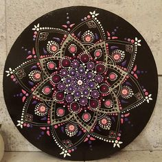 Hand painted Mandala on 12 x 12 wood frame, varnished with thin layers for protection. Can stand alone on a shelve or to a wall, as you desire.