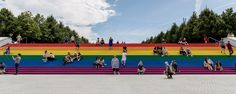 Every four steps feature one of six different colours of the LGBT+ Pride flag, originally designed and created in 1978 by Gilbert Baker. From the base of the steps at ground level, they appear as one large flag measuring metres high by 30 metres wide. Four Freedoms, Stonewall Riots, Roosevelt Island, Louis Kahn, Lebbeus Woods, Park In New York, Old Abandoned Houses, Landscape Architecture, Classical Architecture