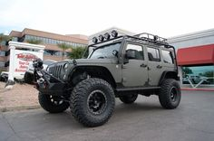"""2015 Jeep Wrangler 4 Door   37x13.50R17 Toyo Tires Open Country M/T   17x8.5 Trophy Fuel Offroad   Poison Spyder Customs, Inc.   WARN Zeon Winch 10K Synthetic Line   American Expedition Vehicles 3.5"""" Lift Kit   Fox Racing Shocks   Smittybilt Fenders   PIAA Lights   KC HiLiTES, Inc. Fog Light Mount Kit   Daystar DRing Isolator Red"""