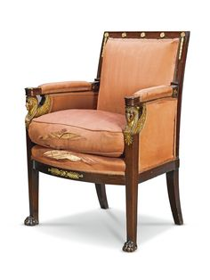 PROPERTY OF A PRIVATE COLLECTION.  A gilt-bronze mounted mahogany and giltwood bergère, by Jacob Desmalter circa 1810.with padded back and cushioned seat, the arm supports in the form of winged sphinx heads above square tapering legs on paw feet, stamped JACOB D.R.MESLEE, with label to backrail 'Marechal Ney / Petit Salon'  Estimate    9,347 - 14,020USD  LOT SOLD. 10,710 USD