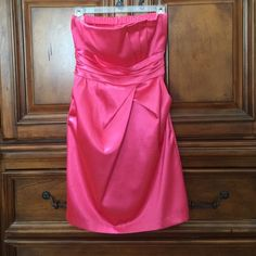 Silk Party Dress ! Beautiful hot pink party dress. Small perfume stain on top right side and bottom right side (as pictured). So comfy and fun, only worn twice! Feel free to make an offer, price is flexible! Size fits a small or medium since it is very stretchy :) size 9 juniors/kids Dresses Strapless
