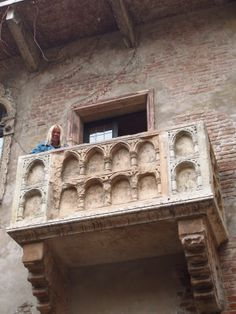 This is the famous balcony at Juliet;s home in Verona.  Is that her out there?