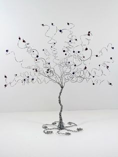 Wire Tree Table Centerpiece Wedding or Home Decor by NouveauTique on Etsy https://www.etsy.com/listing/156746038/wire-tree-table-centerpiece-wedding-or