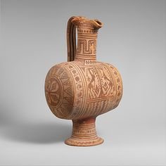 Terracotta barrel-shaped oinochoe (jug). Period: Geometric Date: ca.725–700 B.C. Culture: Etruscan, Italo-geometric. This unusual shape is often found with another distinctive container, a bird-shaped askos. Some scholars have proposed a connection with a wine ritual. Such vases, their painted ornaments heavily influenced by Greek geometric pottery, were produced at Vulci.