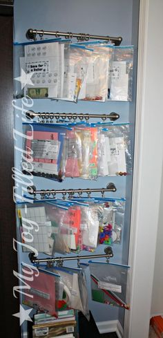 Busy Bag Storage - towel rack & shower curtain clips --Our Homeschool Room Reveal {finally}