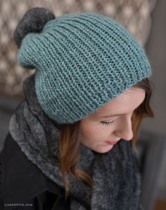 Download this simple knitting pattern to craft a DIY knit hat for the colder months. Make your own fashion statement by adding a yarn or faux fur pom pom!