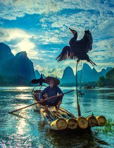 Fisherman & cormorant, Guilin, China by Hamni juni on 500px ~ETS #wow #photography #china
