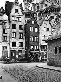 "I believe the business pictured here is the ""Burgerlicious Spice House."" Nice.  Artistically, I love the lines and structure this image creates.  Old Town Cologne, Germany, 1934 Alfred Eisenstaedt"