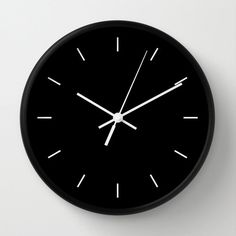 """Modern Clock, Modern Wall Clock, Modern Clock, The Modern Clock, Black and white clock, modern striped clock, modern wall clock by STANLEYprintHOUSE  47.00 USD  Available in natural wood, black or white frames, our 10"""" diameter unique Wall Clocks feature a high-impact plexiglass crystal face and a backside hook for easy hanging. Choose black or white hands to match your wall clock frame and art design choice. Clock sits 1.75"""" deep and requi ..  https://www.etsy.com/ca/listing/26039.."""