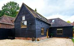 56 Ideas For Wood Stain Swatches Water House Cladding, Exterior Cladding, Exterior House Colors, Exterior Design, Cottage Exterior, Black Exterior, Barn Conversion Exterior, Barn Conversions, Wooden Cladding