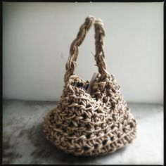 A lovingly hand woven basket by Sydneysider Melissa Kinyon, short handled, 50cm from flat base to top of handle.