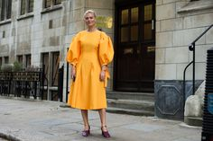 Some of the best street style seen during Fashion Weeks in London, Milan and Paris.  Checkmate: Bishop sleeves in a Rejina Pyo dress worn by Pandora Sykes at the Osman show. Love the goldenrod and rich purple here.