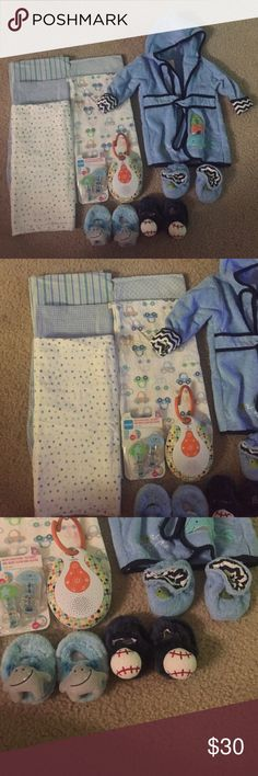 Baby boy lot!! 5 receiving blankets 1 robe with matching slippers 2 additional slippers  2 Mam pacifier clip  On the go sound machine- does not include batteries  Everything in lot has never been used! Everything has been washed in free and clear detergent! Other