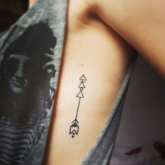 Arrow tattoo. Rib tattoo. Small tattoo. Pretty! Glyphs meaning: explore, challenge and learn