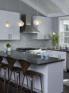 Love the pendant lamps and the faux tile wallpaper backsplash. Terrific Look!