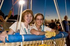 Crew members posing in the basket