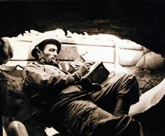 Battle for Iwo Jima, February-March 1945. Movie man writing captions in a dugout: Corporal Atlee Sperry Tracy. Photographed by Campbell, February 24, 1945. U.S. Marine Corps photograph, now in the collections of the National Archives.