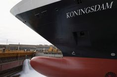 Water touching the hull of Koningsdam for the first time.