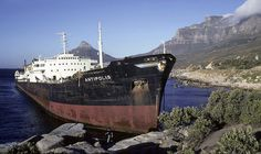 Stranded at Oudekraal 1977 Abandoned Ships, Abandoned Places, Ship Breaking, Merchant Marine, Ghost Ship, Cape Town South Africa, Old Trains, Most Beautiful Cities, Shipwreck