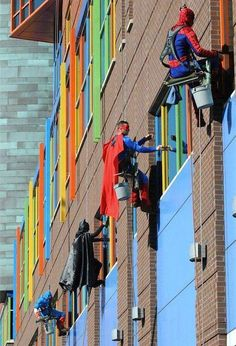 These superheros are window washers at a children's hospital in Pittsburgh