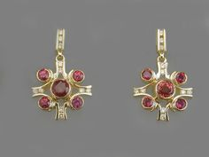 18 Karat Gold, Fancy Colored Sapphires and Yellow Diamonds! Love these!