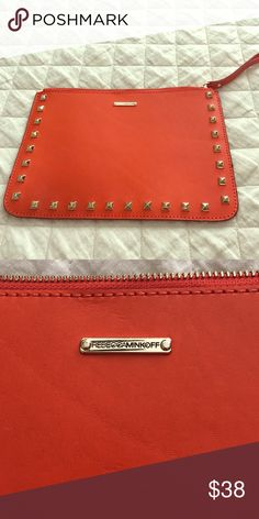 Rebecca Minkoff orange zip clutch Rebecca Minkoff orange zip clutch with gold metal stud detail on both sides. Metal zipper with leather handle. Real leather envelope style clutch. Metal detail with brand on one side. Approximate dimensions 10.5inx7in. Rebecca Minkoff Bags Clutches & Wristlets