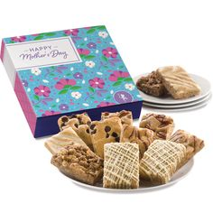 Brighten her Mother's Day with a sweet gift she'll never forget. Fairytale's soft, buttery blondie bars are similar to brownies, except baked with a brown sugar and vanilla batter base instead of chocolate. This gift includes six flavors - Chocolate Chip Blondie, Pecan Blondie, Raspberry White Chocolate, Cheesecake Swirl, Cinnamon Crumb, Lemon Blondie. Cookie Gift Baskets, Cookie Gifts, Chocolate Chip Blondies, Chocolate Cheesecake, Fairytale Brownies, Blondie Bar, White Chocolate Raspberry, Belgian Chocolate, Brownie Cookies