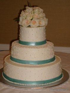 Wedding Cakes- 3 tier, buttercream, green fondant ribbon, scroll work, sugar pearls
