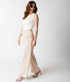 Take it back to the 1940s, dames! This wide leg classic cut is back in a fabulous sandy tan thats guaranteed to turn heads. A banded high waist rests radiantly at the natural waistline, with darling sailor inspired gold button straps and a hidden side zi