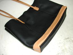 This is a GREAT detailed tutorial (with pictures!) on making a custom leather tote bag. I will be giving this a try for my cruise...