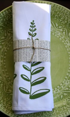 I love the idea of using newspaper to make a napkin ring and then finishing it with twine.