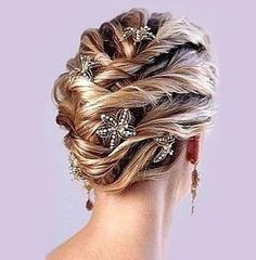 This is a twisted up do where sections are clipped and made to run from one side to another neatly. Stick on some floral hairpins randomly and complete the look  Read more: http://www.stylecraze.com/articles/10-wedding-updos-that-you-can-try-too/#ixzz2UxybUoMW