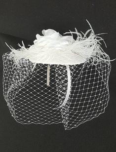 Items similar to Bridal fascinator, White fascinator hat veil, Feather fascinator, Wedding hat on Etsy White Fascinator, Bridal Fascinator, Bridal Hat, Fascinator Hats, Bridal Headpieces, Fascinators, Baby Girl Hats, Girl With Hat, Vintage Birdcage Veils