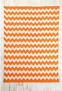 he's on the fence about an orange wall...but he didn't say anything about an orange rug! #laundryroom $74