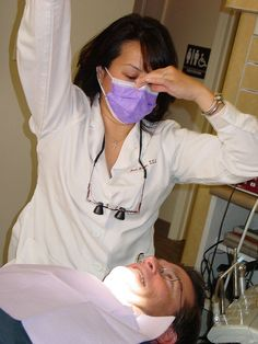 The dentist prepares to examine my mouth     Where to find Dentists who help when insurance doesn't cover my work or if I have No Dental Insurance