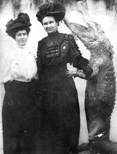 Two women posing with a stuffed alligator. Florida, 1910s. State Archives of Florida, Florida Memory.
