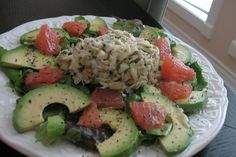 Crab, avocado and pink grapefruit on a bed of romaine