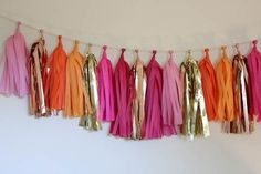 pink, orange, and gold streamers super easy wedding decoration
