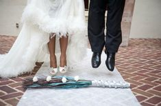 The African-American tradition of Jumping the Broom dates back to before the Civil War, when slaves were not permitted to marry. Couples would jump over a broom in front of witnesses as their way of solidifying their relationship as a wedded couple. This custom is occasionally still practiced in today's  African-American wedding ceremonies as a way of honoring tradition.  Content courtesy of Juliette Weddings, LLC.