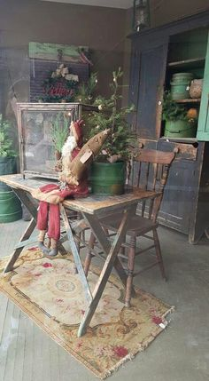 Simple Prim Gathering of Wooden Table and Chair, Rug, and Christmas Tree