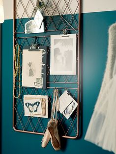 Ikea Barso Trellis (base cutoff and wire spray painted) makes great display board, using hooks and clips