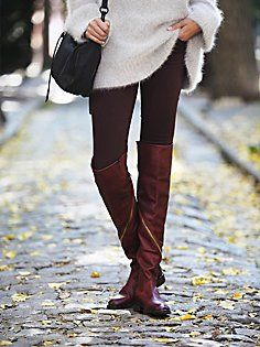 Love how well the leggings go with the boots. The white sweater looks amazing with the rest