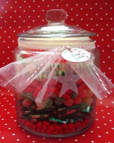 Gingerbread House in a Jar from According to Kelly....  Jar   -Candy  -Frosting  -Ribbon/Tulle/Twine  -Metal Ring Tag
