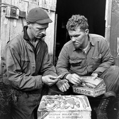 <strong>Not published in LIFE.</strong> American troops study stone and bone implements and other objects recovered from an earlier settlement, Aleutian Islands Campaign, Alaska, 1943.