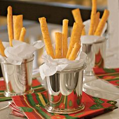 Cheese Straws  When you're not using your silver julep cups for bourbon cocktails, turn them into festive serving containers for cheese straws. Line each cup with a linen napkin to keep the cheese straws upright in the cup and to prevent salt and oils from contact with the silver.