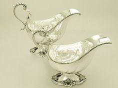 A fine pair of antique George V sterling silver Regency style sauceboats; part…